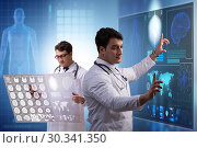 Купить «Doctor in telemedicine concept looking at x-ray image», фото № 30341350, снято 21 марта 2019 г. (c) Elnur / Фотобанк Лори