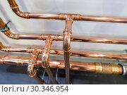 Купить «Copper pipelines. Modern heating system», фото № 30346954, снято 12 февраля 2019 г. (c) Андрей Радченко / Фотобанк Лори