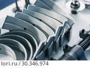 Купить «Semicircular metal liners for an internal combustion engine», фото № 30346974, снято 6 июня 2018 г. (c) Андрей Радченко / Фотобанк Лори