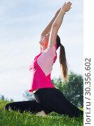 Купить «Female in pink T-shirt is practicing stretching», фото № 30356602, снято 10 июня 2017 г. (c) Яков Филимонов / Фотобанк Лори