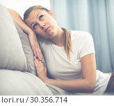 Купить «Girl is bored at lonely», фото № 30356714, снято 4 октября 2017 г. (c) Яков Филимонов / Фотобанк Лори