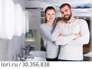 Купить «Young family couple choosing bathroom sink in store», фото № 30356838, снято 2 февраля 2018 г. (c) Яков Филимонов / Фотобанк Лори