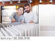 Купить «couple looking laminated flooring», фото № 30356918, снято 2 февраля 2018 г. (c) Яков Филимонов / Фотобанк Лори