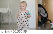 Купить «Active and happy baby girl at home», видеоролик № 30356994, снято 20 марта 2019 г. (c) Данил Руденко / Фотобанк Лори