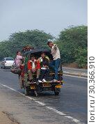 Купить «The people of India go by transport», фото № 30366910, снято 15 ноября 2012 г. (c) Игорь Жоров / Фотобанк Лори