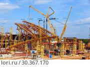 Купить «SAMARA, RUSSIA - April 2016: Construction of a modern stadium for the football world cup Cosmos Arena.», фото № 30367170, снято 1 июня 2016 г. (c) Акиньшин Владимир / Фотобанк Лори