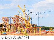 Купить «SAMARA, RUSSIA - April 2016: Construction of a modern stadium for the football world cup Cosmos Arena.», фото № 30367174, снято 1 июня 2016 г. (c) Акиньшин Владимир / Фотобанк Лори