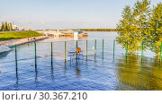 The sports ground on the Volga river bank is flooded during the spring flood in the Spring sunny day. Стоковое фото, фотограф Акиньшин Владимир / Фотобанк Лори