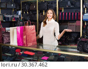 Купить «Portrait of woman selling wallets and purses», фото № 30367462, снято 25 июня 2019 г. (c) Яков Филимонов / Фотобанк Лори