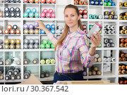 Купить «Woman shopping acrylic color spray can», фото № 30367542, снято 12 апреля 2017 г. (c) Яков Филимонов / Фотобанк Лори