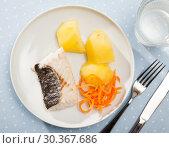 Купить «Top view of steamed hake with potatoes, grated carrot», фото № 30367686, снято 24 апреля 2019 г. (c) Яков Филимонов / Фотобанк Лори