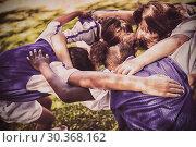 Купить «Rear view of soccer team forming huddle », фото № 30368162, снято 24 марта 2019 г. (c) Wavebreak Media / Фотобанк Лори