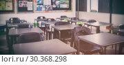 Купить «Empty classroom with desks and chairs», фото № 30368298, снято 5 июня 2020 г. (c) Wavebreak Media / Фотобанк Лори