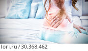 Купить «Digital composite of highlighted spine of woman with back pain», фото № 30368462, снято 22 марта 2019 г. (c) Wavebreak Media / Фотобанк Лори