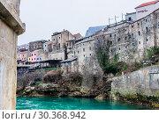 City of Mostar on the Neretva River, Bosnia-Herzegovina (2018 год). Редакционное фото, фотограф Николай Коржов / Фотобанк Лори