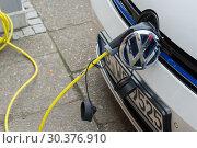 Купить «Charging process on an electric car from VW», фото № 30376910, снято 13 марта 2017 г. (c) Caro Photoagency / Фотобанк Лори