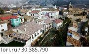Купить «View from drone of roofs of houses in traditional village of Liedena in foggy morning, Navarre, Spain», видеоролик № 30385790, снято 23 декабря 2018 г. (c) Яков Филимонов / Фотобанк Лори