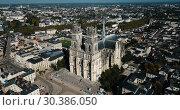 Купить «Aerial view of Orleans old center and Sainte-Croix Cathedral, France», видеоролик № 30386050, снято 24 октября 2018 г. (c) Яков Филимонов / Фотобанк Лори