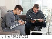 Купить «Father helping son to do homework», фото № 30387762, снято 8 февраля 2019 г. (c) Яков Филимонов / Фотобанк Лори