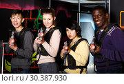 Купить «people of different nationalities with laser pistols posing together», фото № 30387930, снято 23 января 2019 г. (c) Яков Филимонов / Фотобанк Лори