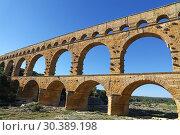 Купить «Pont du Gard, an ancient Roman aqueduct in France», фото № 30389198, снято 26 июня 2018 г. (c) Anton Eine / Фотобанк Лори