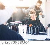 Купить «guy stylist creating haircut for man client at hairdressing salon», фото № 30389654, снято 27 января 2017 г. (c) Яков Филимонов / Фотобанк Лори