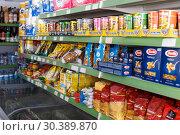 Купить «Supermarket shelf with foodstuff goods», фото № 30389870, снято 7 ноября 2018 г. (c) Яков Филимонов / Фотобанк Лори