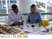 Купить «Caucasians architects discussing over blueprint at desk in office», фото № 30390366, снято 21 ноября 2018 г. (c) Wavebreak Media / Фотобанк Лори