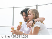 Купить «Caucasian couple siting at promenade while having ice cream cone », фото № 30391266, снято 12 ноября 2018 г. (c) Wavebreak Media / Фотобанк Лори