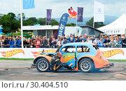 Купить «The Hot Wheels Make it Epic Tour races into CarFest North Featuring: Stuntman Terry Grant completes daring action stunts in a life-size Hot Wheels car...», фото № 30404510, снято 29 июля 2017 г. (c) age Fotostock / Фотобанк Лори