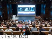 Купить «Medical expert giving a talk on diagnostics in medicine on 12th Winfocus world congress on 8th of September, 2016 in Ljubljana, Slovenia.», фото № 30413762, снято 7 сентября 2016 г. (c) Matej Kastelic / Фотобанк Лори