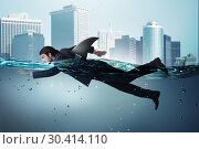 Купить «Businessman with shark fin swimming in water», фото № 30414110, снято 20 апреля 2019 г. (c) Elnur / Фотобанк Лори