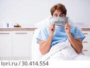 Купить «Young male patient lying on couch in hospital», фото № 30414554, снято 2 октября 2018 г. (c) Elnur / Фотобанк Лори