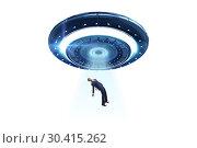 Flying saucer abducting young businessman. Стоковое фото, фотограф Elnur / Фотобанк Лори
