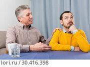Купить «Mature father and son serious talk», фото № 30416398, снято 20 апреля 2019 г. (c) Яков Филимонов / Фотобанк Лори