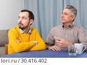 Купить «Mature father and son serious talk», фото № 30416402, снято 18 июня 2019 г. (c) Яков Филимонов / Фотобанк Лори