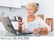 Купить «Woman making order by phone», фото № 30416586, снято 11 июля 2018 г. (c) Яков Филимонов / Фотобанк Лори