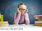 Купить «Pretty Primary Student Girl Look Tired Study Home», фото № 30417274, снято 9 февраля 2019 г. (c) Иван Карпов / Фотобанк Лори
