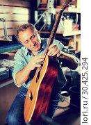 Купить «Adult man musician with acoustic guitar», фото № 30425294, снято 18 сентября 2017 г. (c) Яков Филимонов / Фотобанк Лори