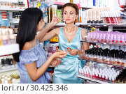 Купить «Stylish girl shopping with mother in cosmetics store, choosing n», фото № 30425346, снято 21 июня 2018 г. (c) Яков Филимонов / Фотобанк Лори