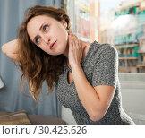 Купить «Woman holding hands on her sore neck», фото № 30425626, снято 22 апреля 2019 г. (c) Яков Филимонов / Фотобанк Лори