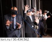 Купить «Excited man in virtual reality room», фото № 30434562, снято 29 января 2019 г. (c) Яков Филимонов / Фотобанк Лори