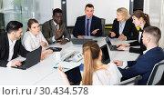 Купить «International group of confident business colleagues planning work», фото № 30434578, снято 10 марта 2018 г. (c) Яков Филимонов / Фотобанк Лори