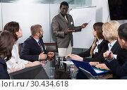Купить «man giving presentation to colleagues at international business meeting», фото № 30434618, снято 12 февраля 2018 г. (c) Яков Филимонов / Фотобанк Лори