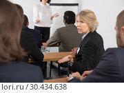 Купить «Discontent senior woman turning to other participants», фото № 30434638, снято 12 февраля 2018 г. (c) Яков Филимонов / Фотобанк Лори