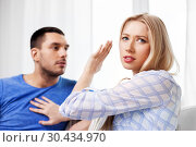 Купить «unhappy couple having argument at home», фото № 30434970, снято 9 февраля 2014 г. (c) Syda Productions / Фотобанк Лори