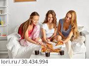 Купить «happy friends or teen girls eating pizza at home», фото № 30434994, снято 14 ноября 2015 г. (c) Syda Productions / Фотобанк Лори