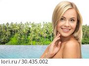 Купить «happy woman over infinity edge pool in sri lanka», фото № 30435002, снято 30 марта 2013 г. (c) Syda Productions / Фотобанк Лори