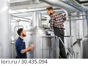 Купить «men with clipboard at brewery kettle or beer plant», фото № 30435094, снято 24 марта 2017 г. (c) Syda Productions / Фотобанк Лори