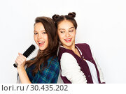 Купить «teenage girls singing to hairbrush and having fun», фото № 30435202, снято 19 декабря 2015 г. (c) Syda Productions / Фотобанк Лори